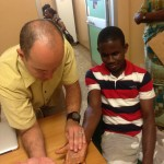 Hand surgeon with Patient in Ghana